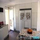 Zona de almacenamiento con despensas y frigoríficos en cocina reformada en Massamagrell