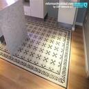 Vista de pavimento nuevo simulación hidráulico en unión con tarima flotante en reforma cocina realizada en Vall d'Uixo