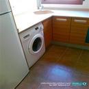 Detalle de pequeña cocina reformada en Valencia en zona lavadora