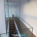 Vista general de barandilla de cristal en planta alta