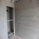 foto1369 Ejecución-Enlucidos / Pared de habitación terminada con yeso