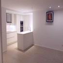 foto1432 Cocina-Final / Vista desde comedor de la isla abierta en reforma apartamento