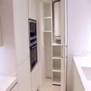foto1458 Cocina-Final / Detalle de despensa con puertas plegadas y termo eléctrico en interior